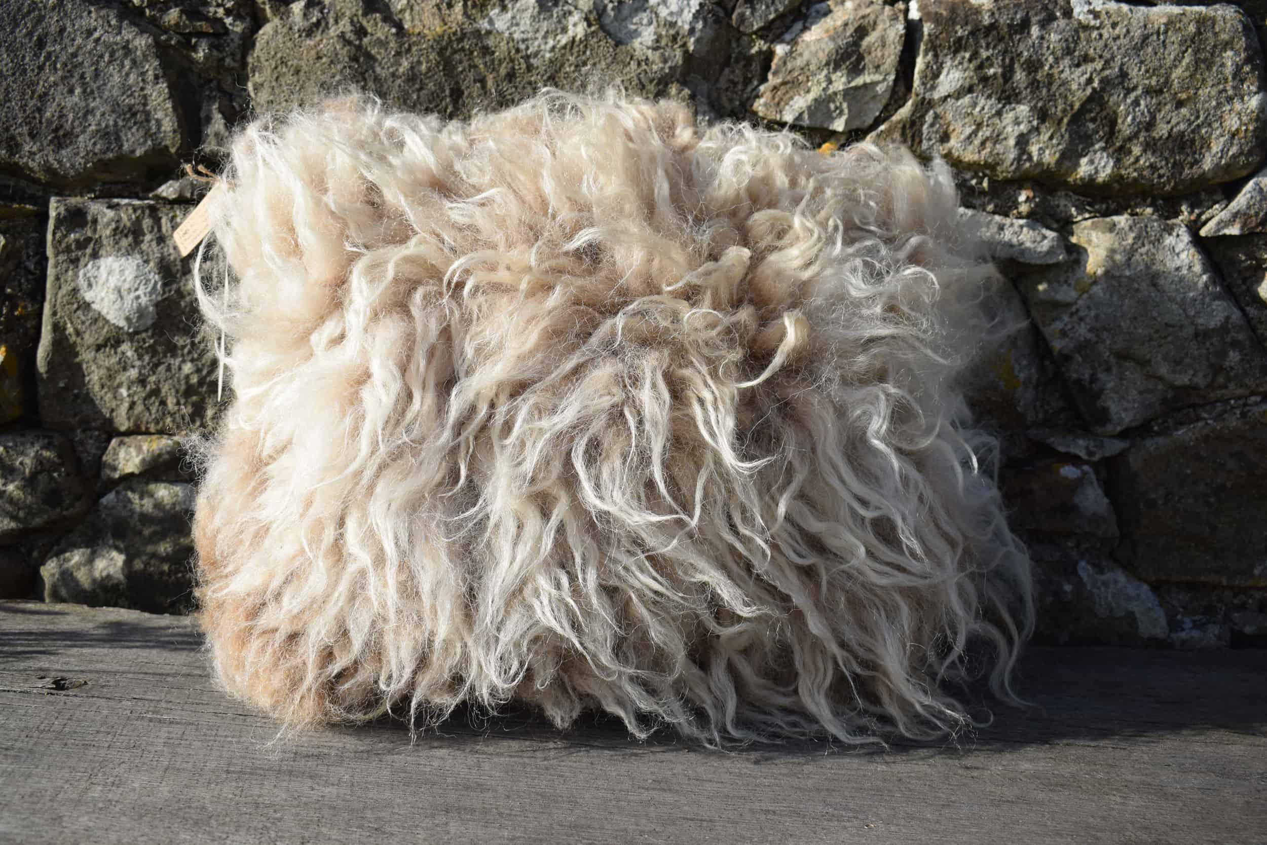 felted fleece vegetarian sheepskinpegloom woven wool cushion handmade moorit grey brown natural wool patchwork sheep