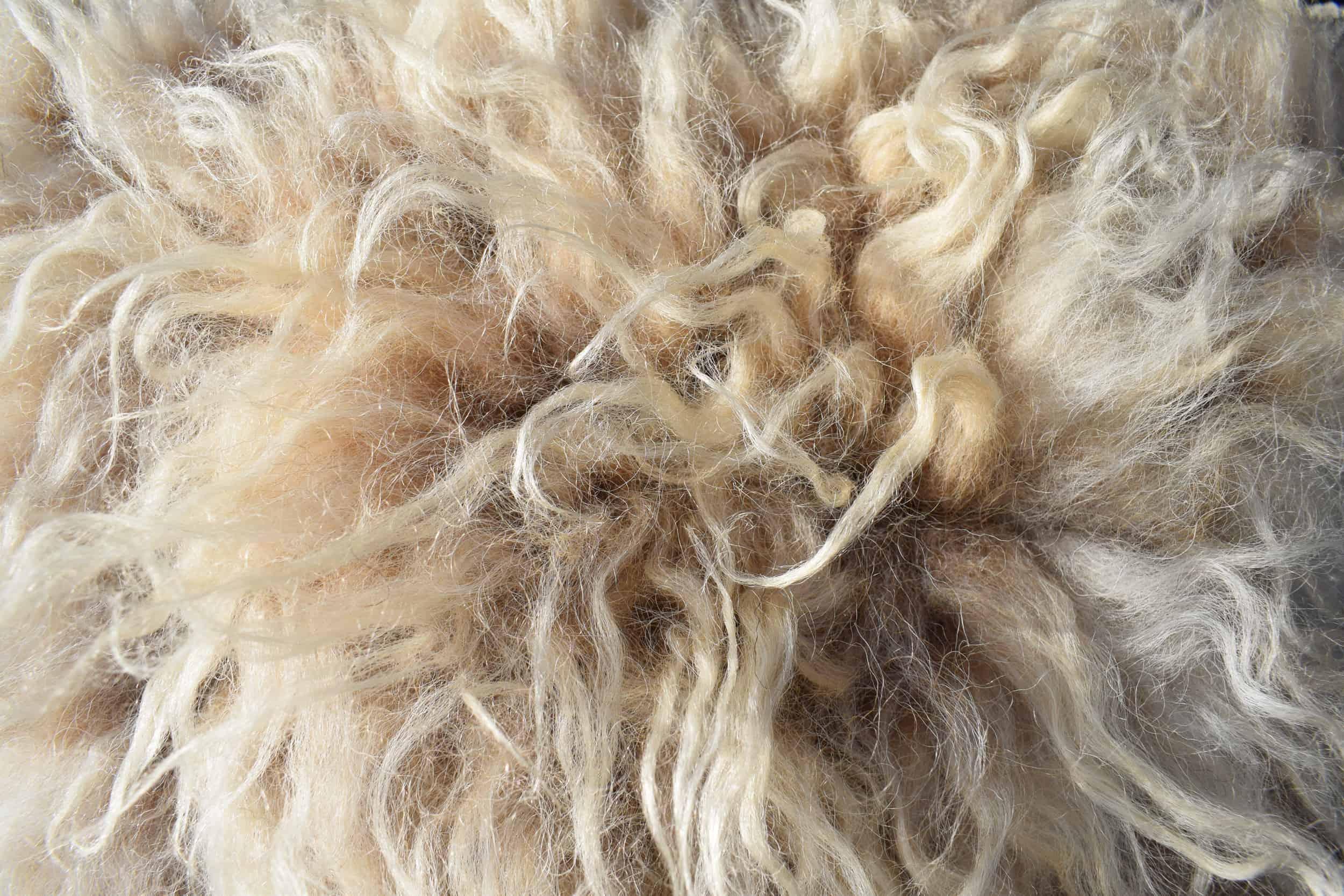 felted fleece wool sheepskinpegloom woven wool cushion handmade moorit grey brown natural wool patchwork sheep
